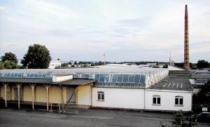 Fabrikanlage mit Holzarkaden in der Zeppelin- und Hardeckstraße.